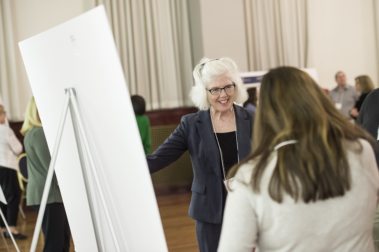 Laurie Kirsch — Vice Provost for Faculty Affairs, Development, and Diversity — discusses a poster at the Extended Diversity Experience poster session, on April 19, 2018.