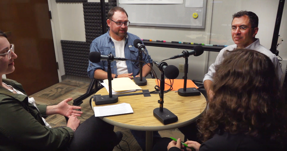Group of faculty in the Media Creation Lab producing a podcast