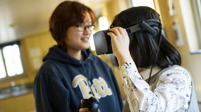 Students Using Immersive Technology In A Classroom