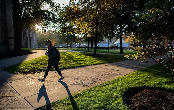 Student Walking On Campus Near Cathedral Of Learning